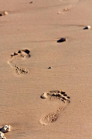 footprints on the sand Stock Photo