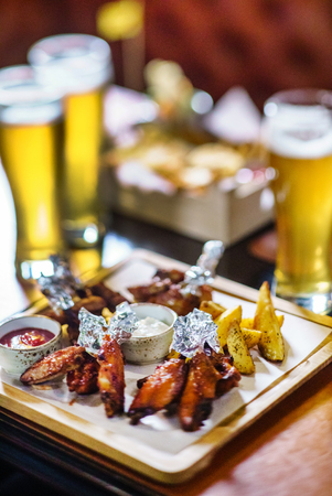 bbq buffalo wings with beer Stock Photo