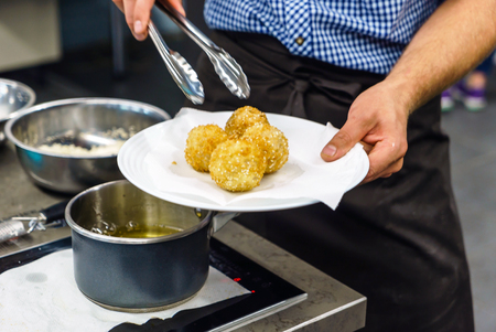 chef making arancini