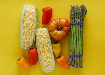 fresh vegetables on the yellow background