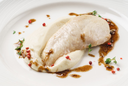 chicken with mashed potato on the white plate