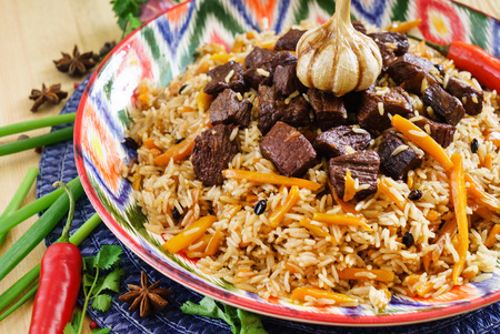 Pilaf with mutton, carrots, onions, garlic, pepper and cumin. A traditional dish of Asian cuisine.