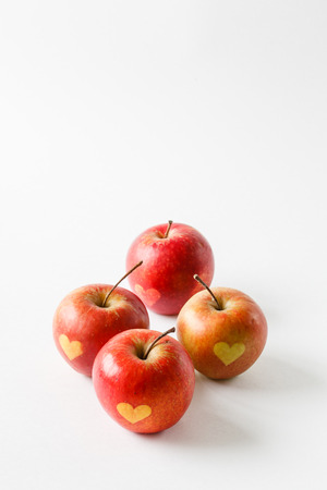 Red apples with a heart symbol Stock Photo