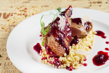 duck with cranberry sauce and couscous