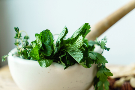 mortar with fresh herbs