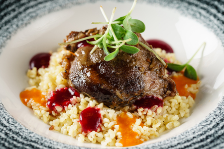 pork with couscous Stock Photo