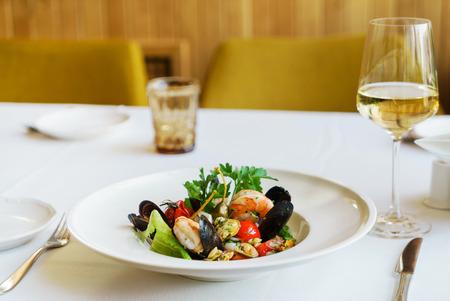 seafood pasta set on table