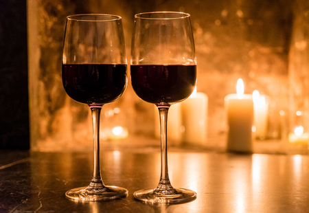 candle: wine and a fire