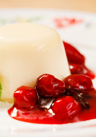 Panna cotta with berry sauce Stock Photo