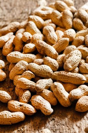 peanuts on wood background Banco de Imagens