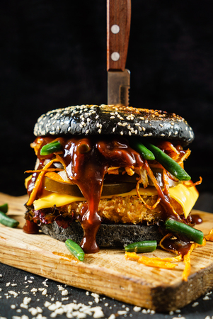 creative black burger with beef and bacon Imagens