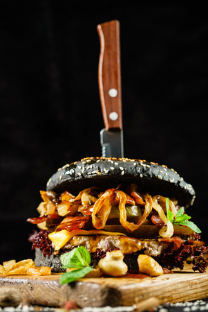 creative black burger with beef and bacon Stock Photo