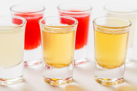 Glasses with  alcoholic drink on white background Stock Photo