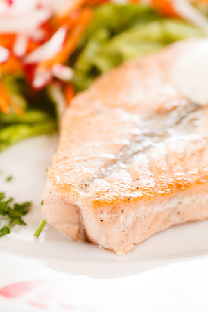 fryed: salmon steak with vegetables