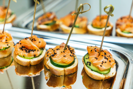 catering table with open sandwiches