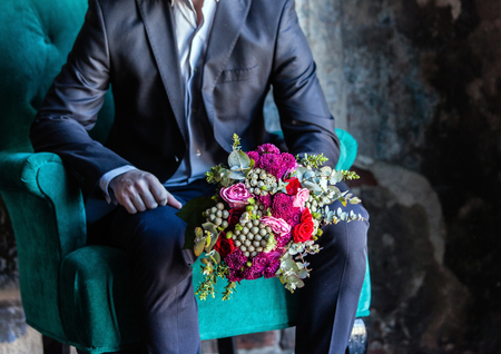 wedding bouquet in groom hands Stock Photo