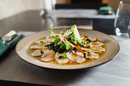 fish carpaccio with salad Imagens