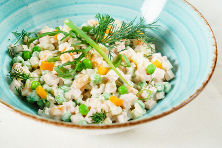 russian salad in the blue bowl