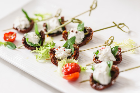 tasty canape with mozzarella