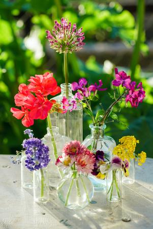 summer flowers in the glass bottles Stok Fotoğraf