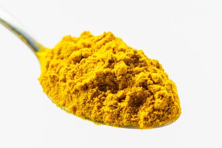 turmeric powder on the spoon