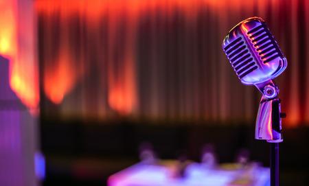 Stylish retro microphone on a colored background Foto de archivo