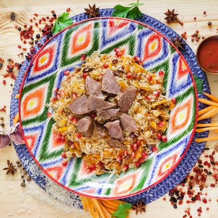 pilaf with beef, vegetables and pomegranate seeds