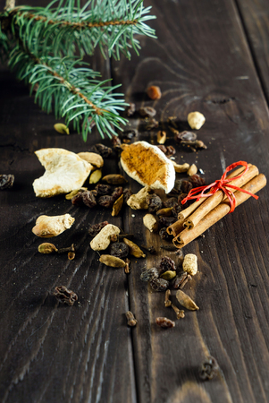 winter spices on wooden background