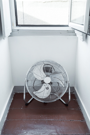electric fan  near window