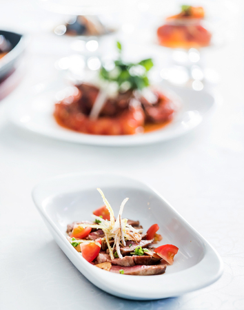 sliced beef with vegetable garnish