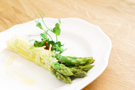 roasted asparagus on the white plate