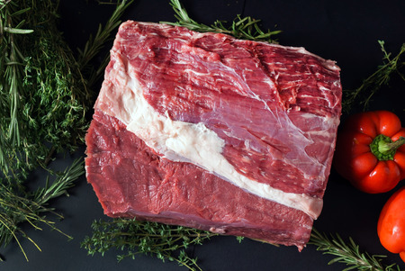 raw meat on black background