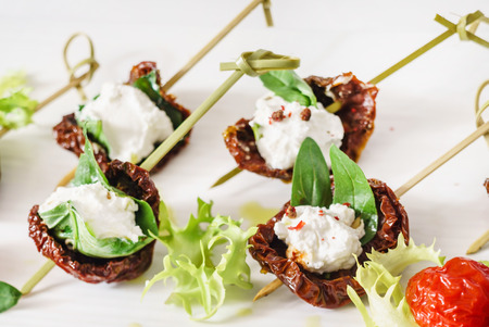 tasty canape with dried tomatoes