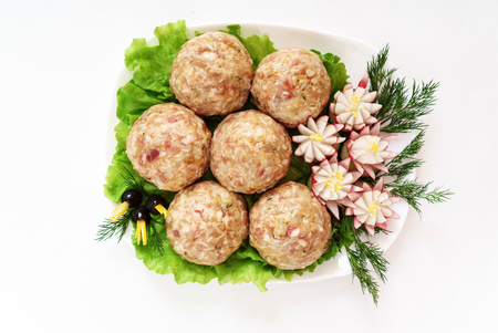 raw meatballs on white background