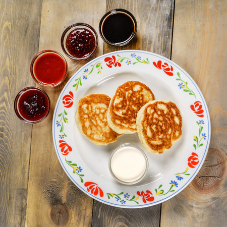 pancakes on the wooden background Stock Photo