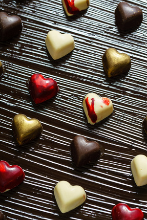 chocolate hearts on black background Stock Photo
