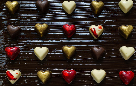 chocolate hearts on black background Stock fotó