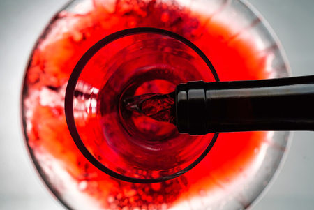Red wine pouring in decanter 스톡 콘텐츠
