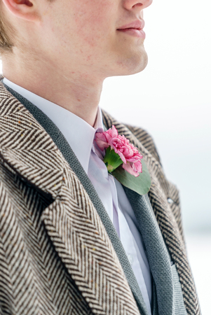 elegant groom with flowers