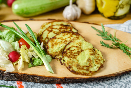 zucchini pancakes with salad