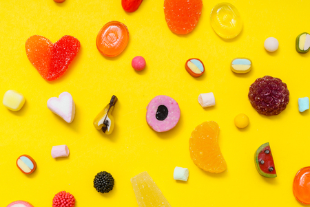 colorful candy on the yellow background Stockfoto - 96384057