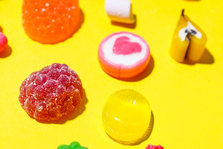 colorful candy on the yellow background Stockfoto - 96398546