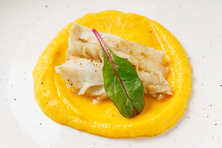 fish with pumpkin puree Stock Photo