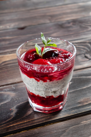 berry dessert on wooden background