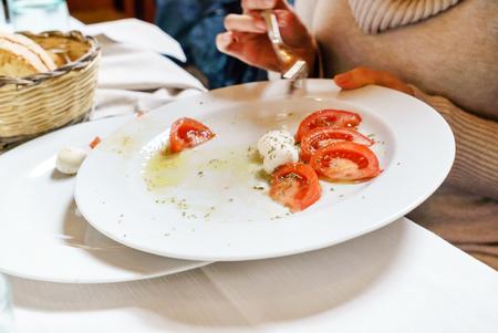 caprese salad in the restaurant Stock Photo