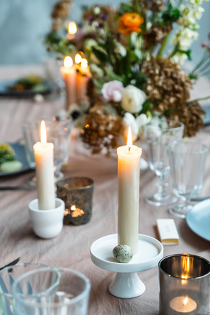 Easter table with candles Stock Photo