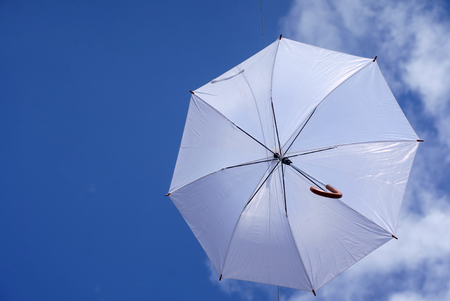 umbrella flying on a blue sky Stock Photo