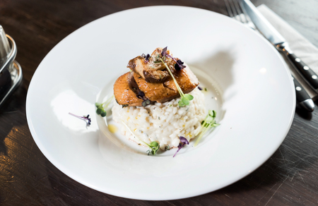 risotto with duck and mushrooms Stock Photo