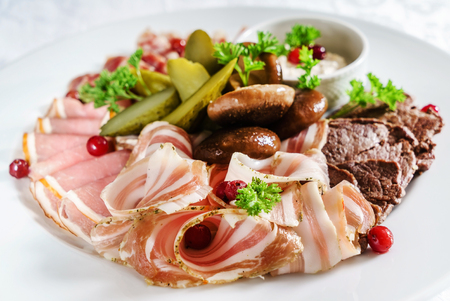 meat appetizer on white plate Stock Photo - 99579491