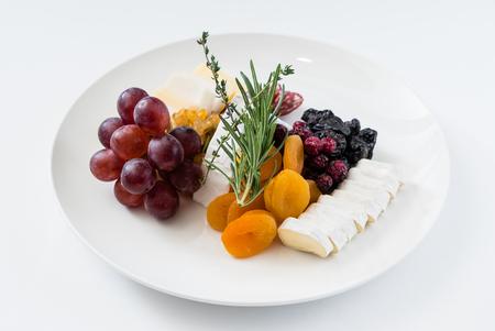 cheese plate with grapes Archivio Fotografico - 100411482